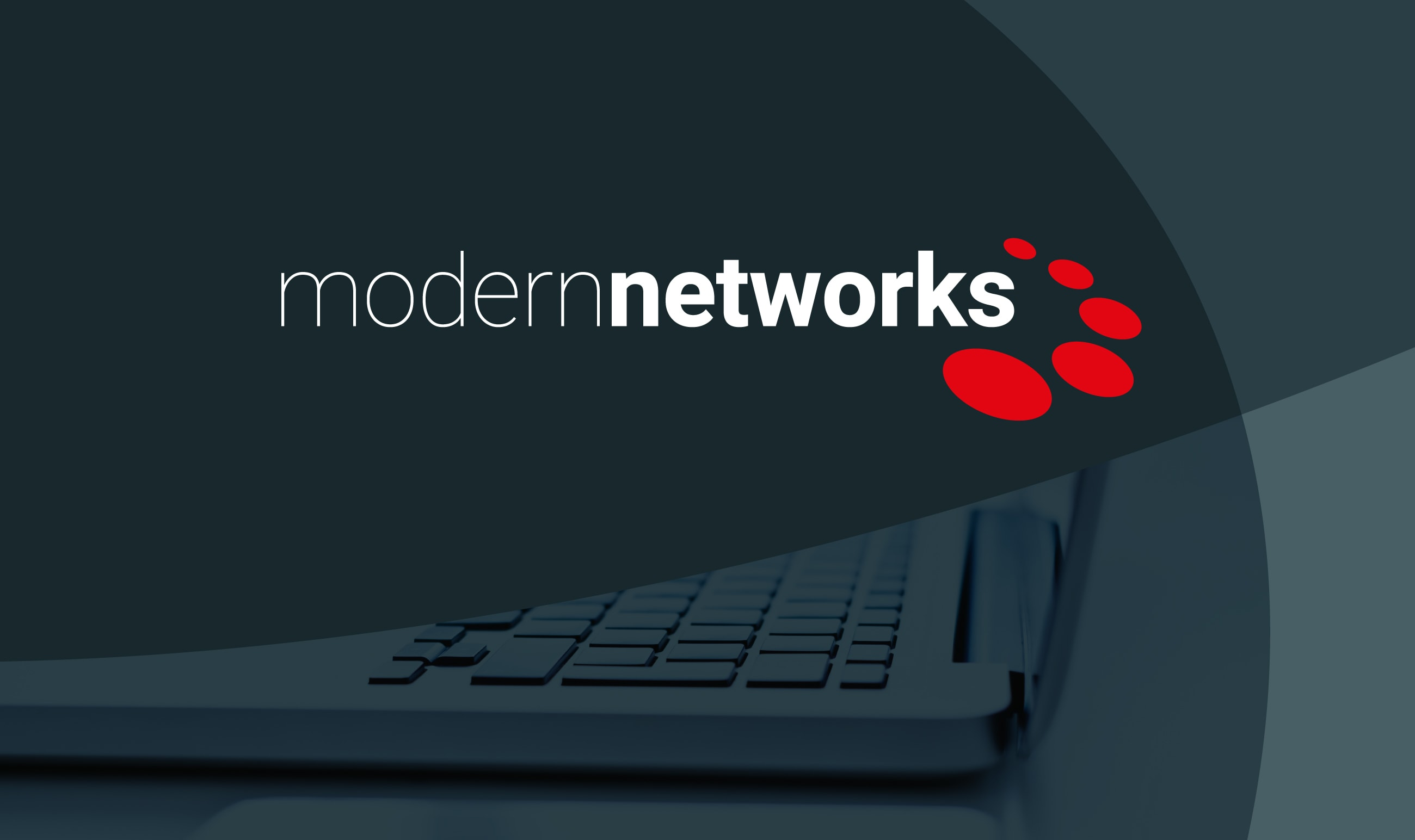 Modern Networks logo white text on a grey background with red oval graphics around the 's'.