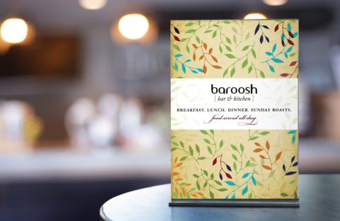 Baroosh, Hertfordshire interior shot focusing on a menu on a table.